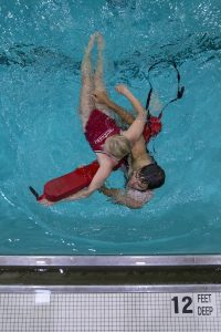 Ian Clute practices rescuing Alicia Gleason during lifeguard in service training Tuesday, June 21, 2016, at the Turner Community Center pool. The pool has been closed while undergoing renovations and is expected to reopen before the start of the season. Photo by Mike Clark.