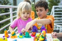 Siblings Victoria and Bennett Thompson play with Play-Doh during second annual Summerfest following the Old First Night run hosted by NOW Generation, an organization made for by and of the younger generations of Chautauquans at the Youth Activities Center on August 1, 2015.